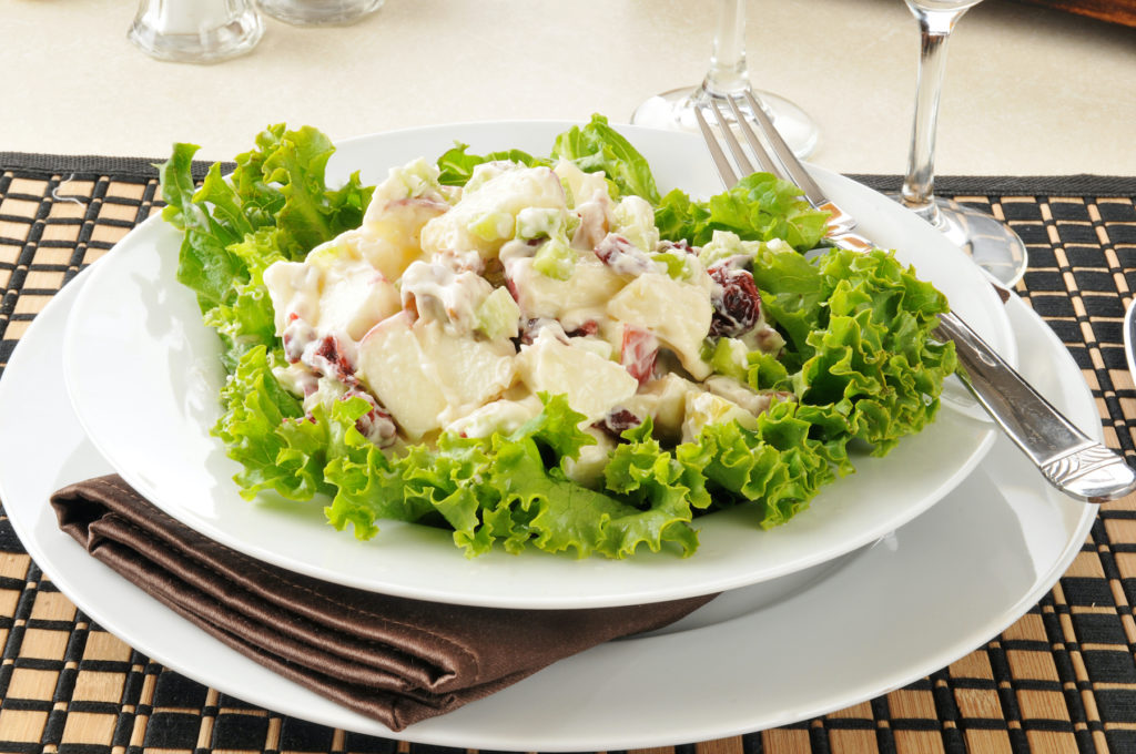 A Waldorf salad with lettuce, apple and walnuts