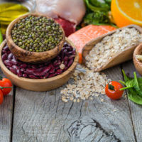 Selection of food that is good for the health and skin, rustic wood background